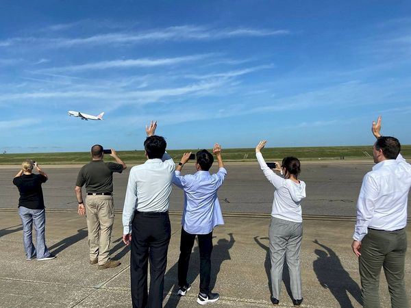Taiwan's Representative to the US Hsiao Bi-khim (second right) waves as the plane carrying the shipment of Moderna vaccines takes off on Saturday in Memphis, Tennessee